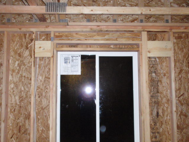 The two retangular pieces of wood on the outside of the window framing are examples of window covering supports that Tony added.