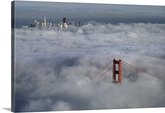 a-glowing-tower-of-the-golden-gate-bridge-rises-above-the-fog-san-francisco-bay-california,ng38494